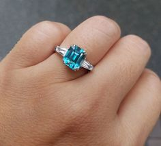 3 Stone Emerald Cut Blue Zircon Ring (Hand View) - image from Right Hand Rings, Blue Zircon, Ring Finger, Emerald Cut, White Gold Rings, View Image, Fingers, Gems, Engagement Rings