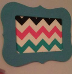 Teal painted frame with chevron fabric