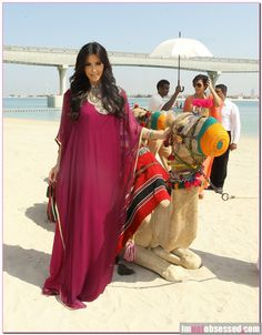 Kim Kardashian And Kris Jenner Ride Camels In Dubai Kim Kardashian rides a camel with her mom at the Atlantis resort in Dubai – Celeb Gossip, Celeb News and Celeb Pictures by I'm Not Obsessed