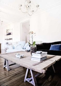 ... ♥ ... Rustic trestle coffee table. Love the aged wood.