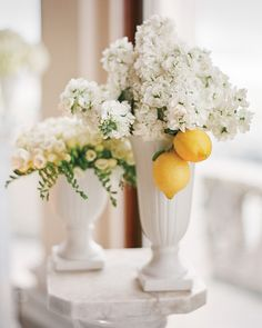 Lemons gave these cloud-like clusters of white freesias and hydrangeas a sunny pop at the historic San Francisco mansion where this couple hosted their reception.