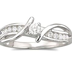 Something like this is what I'd really like. The curving part would be the engagement ring, then a band with small inset diamonds for the wedding band.  Of course, I want it to be interlocking and have the two separate parts through the whole ring, therefore crossing at the top and at the bottom. Think it would be beautiful.