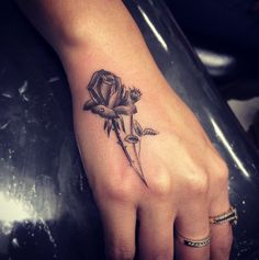 Rose on hand by Isaiah Negrete