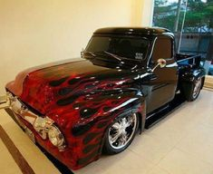 1954 Ford Custom Black Pick Up with Cherry Red Hot Flames.