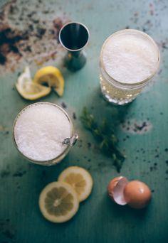 Lovage and Gin Fizz - Egg White, Gin, Lemon Juice, Lovage Soda Syrup, Half and Half, Club Soda.