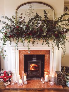 My Home At Christmas (+ How To Make This Fireplace Garland) How to make this real flower fireplace over mantle Christmas garland with eucalyptus, red roses, thistles and cotton flowers. Christmas Fireplace Garland, Christmas Mantels, Christmas Home, Christmas Wreaths, Mantle Garland, Garland Decoration, Christmas Villages, Silver Christmas, Victorian Christmas