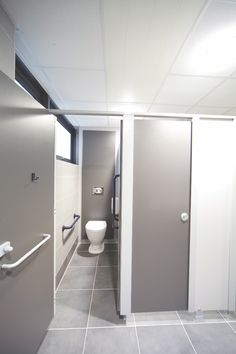 modern toilet wc design at a commercial office tiles from solus ceramics