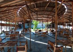 Salvaged Ring coffee house by a21studĩo is made from scrap wood