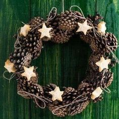 Cone wreath decoration with bread stars on green wood surface Best Picture For DIY Wreath indoor For Your Taste You are looking for something, and it is going to tell you exactly what you are looking Pine Cone Crafts, Wreath Crafts, Diy Wreath, Wreath Ideas, Fall Wreaths, Christmas Wreaths, Christmas Decorations, Xmas, Christmas Christmas