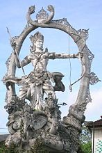 Vana Parva -Vana Parva dedicates many chapters on Arjuna (pictured above in Bali, Indonesia). Arjuna visits heaven, meets Indra and other deities, receives celestial weapons as gifts. When he returns to the forest home of Pandava brothers, he demonstrates to them their power by destroying an aerial city. Sage Narada appears, demands to know why he is wrongly unleashing weapons of war without cause, just to show off. Arjuna stops the violence.