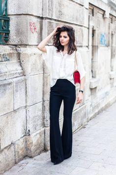 Black pants, whit blouse, color purse