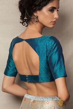 In a gorgeous shade of Teal Green, marvellous tanchoi weave and delicate touches of zari, this blouse is certain to become your new favourite.A chic boat n Brocade Blouse Designs, Blouse Designs High Neck, Simple Blouse Designs, Stylish Blouse Design, Designer Blouse Patterns, Saree Blouse Designs, Indian Blouse Designs, Kurta Designs, Blouse Styles