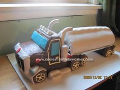 Homemade Semi Trailer Truck Cake: The tank is a chocolate roll cake with marshmallow cream filling. We added 2 cherry Twizzlers on the top, and rolled in fondant. The truck is made of 2