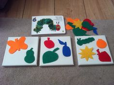 Felt images with Velcro on canvas.  Easy for babe/toddler to hold and touch or point to while book is being read.  As child grows then you can use the loose felt images as a matching game.  Teaches colours, names, numbers, grouping, sorting.