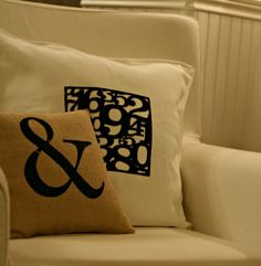 """(originally for Silhouette) Love the """"&"""" pillow.  I'm picturing this with cheap white pillows, a freezer paper template, and fabric paint."""
