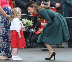Pin for Later: 38 Snaps of Kate Middleton With Little Girls That Are Sure to Make Your Heart Explode  Kate bent down to chat eye to eye with a young fan in Aldershot, England, on St. Patrick's Day in 2012.