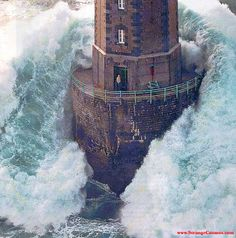 Photo of Jument Lighthouse, about to be engulfed by a huge wave.  Taken by photographer Jean Guichard, 1989.  As one of the most violent storms in history ravaged the northern coast of France, the lighthouse keeper, Theodore Malgorne, stood at the opened door of the lighthouse, thinking that Guichard's was the rescue helicopter.  He realised his mistake and returned inside just in time to save his life.