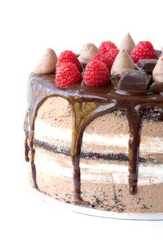 Raspberry Marshmallow Chocolate Layer Cake with four layers of chocolate cake, topped with raspberry sauce, marshmallow frosting and chocolate buttercream. Chocolate Buttercream, Chocolate Cream, Chocolate Ganache, Brownies, Marshmallow Frosting, Thanksgiving, Cake Board, Round Cakes, Cake Tins