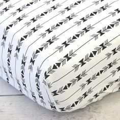 A fun black and white tribal crib sheet that would work with almost any tribal nursery design!