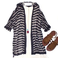 For Those Chilly Summer Nights.. Halt It Out Tunic $42 (Online & In Store). Charcoal Striped Cardigan $38. Fringe Benefit Sandal $38. (Online + In Store) Stoned Tassel Chain $22.  #elysianlove #stripes #summer #fringe #halter