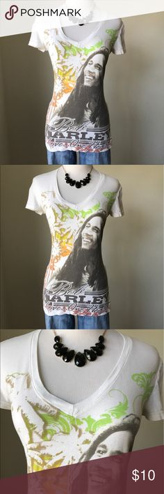 Bob Marley T-Shirt Graphic T Shirt with Bob Marley One Love One Heart. Need to double check sizing in this. Simple but cute top for the summer. Has been worn but has no tears, rips or stains. Comes from a pet and smoke free home Tops Tees - Short Sleeve