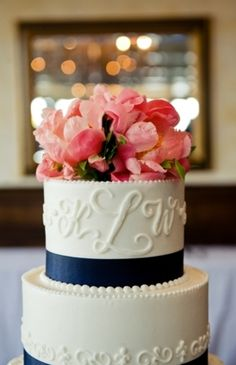 Coral and navy wedding cake. Coral reception wedding flowers,  wedding decor, wedding flower centerpiece, wedding flower arrangement, add pic source on comment and we will update it. www.myfloweraffair.com can create this beautiful wedding flower look.