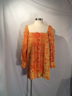 Hey Sunshine, check out this vintage orange dress hippie boho dress off or on by Glassthatrocks, $25.00