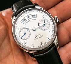 "IWC Portugieser Annual Calendar Watch Hands-On - by Ariel Adams - See all the hands-on pictures & read more on aBlogtoWatch.com ""For me, the most impressive element of the 2015 IWC Portugeiser Annual Calendar watch is the movement. Flip the large 44.2mm wide case on its rear, and through the expansive sapphire crystal caseback window, you'll see what is a fantastic example of modern mechanical watch movements - the in-house made IWC caliber 52850..."""