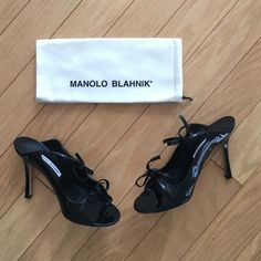 Manolo Blahnik Claudia Patent Leather Slides Only worn once! Comes with box and dust bag. Slight scuffing on sides. Barely noticeable. Bow detail. Gorgeous!! Size 38. Fits 7.5. 4 inch stiletto heels. No trades!! Manolo Blahnik Shoes Heels