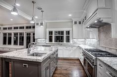 white+cabinets+kitchen | Macavoy Modern White Kitchen Kitchen with Granite Counters and a White ...