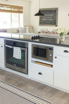 Appliance arrangement - range (gas), oven and microwave all on the island.