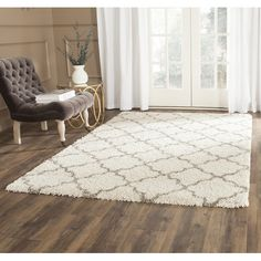 Davis Ivory/Gray Shag Area Rug. (I'd like something a little more neutral than our current rug, but this is a lower priority for now I guess.) Ours is currently 10' x 7.8'. This rug is $318 for 8x10'.