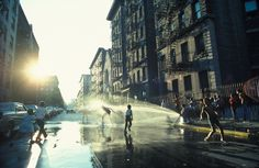 A fire hydrant refreshes youngsters on a hot day in Harlem, New York, 1977. PHOTOGRAPH BY LEROY H. WOODSON, NATIONAL GEOGRAPHIC