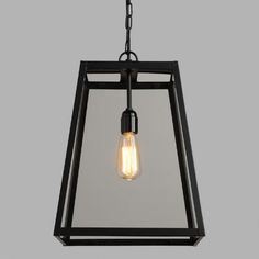 Our sleek Four-Sided Glass Hanging Pendant Lantern is finely crafted in India of black-finished metal and clear individual panes of glass. Surprisingly affordable, this unique pendant's industrial style and clean silhouette pairs perfectly with ambient lights like our Edison Filament Bulb.
