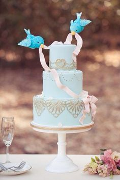 Cinderella inspired cake: I want to incorporate the little blue birds somehow...