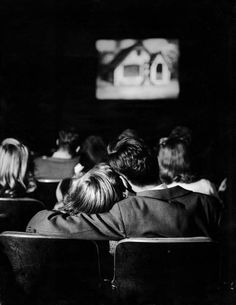 "Teenagers ""necking"" in a movie theater. Location: Webster Groves, MO, US Date taken: December 11, 1944 Photographer: Nina Leen"