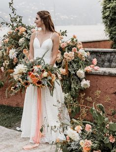 Truvelle Wedding Dress- We cannot get over these lush summer wedding flowers! Dahlias, garden roses, carnations and tons of greenery! They really added to the garden feel of the Lake Como wedding!