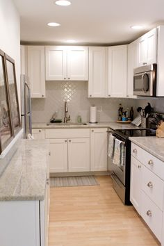 This works. Nice tiles. Simple cabinets. Grey counter top? like this color gray counter tops