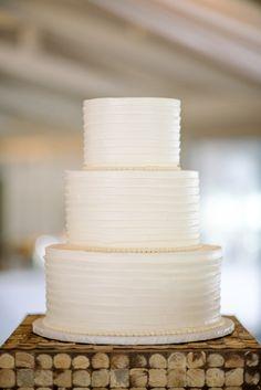 classic white wedding cake, photo by Sean Money + Elizabeth Fay http://ruffledblog.com/glittered-charleston-wedding #cakes #desserts