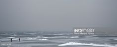 Foto de stock : Panoramic view of two people Ice skating in The Netherlands. Frozen sea