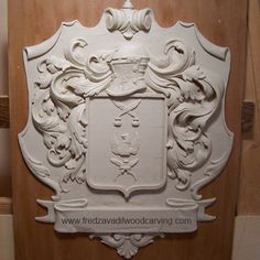 Clay model for carved family crest