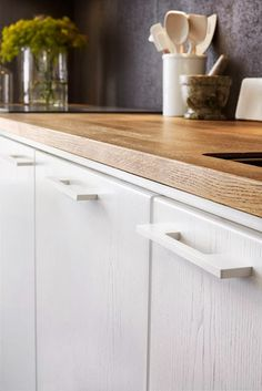 Economical: Painted plywood and butcher-block countertop.