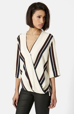 Free shipping and returns on Topshop Drape Front Blouse at Nordstrom.com. Rich stripes pattern the cream-colored surface of a V-neck blouse styled with elbow sleeves and a surplice wrap that lends draped dimension to the front panel.