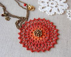 This is a new necklace design based on the Crochet Sun Necklace . It is made using a lovely antique brass round chain with a small brass f...