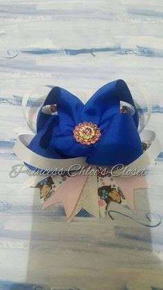 Check out this item in my Etsy shop https://www.etsy.com/listing/268810373/blue-pink-and-gold-bling-bow