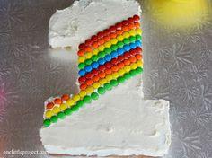 Rainbow M's first birthday cake   onelittleproject.com