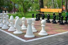 Giant chess. Possibly simplify this. By cutting board parts & painting board and having costumes or props so people can identify what pieces they are.