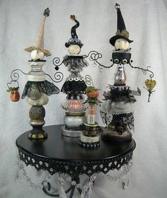 This link is broken... but these totem witches are just too cute not to pin. I am sure I can figure them out on my own, just random finials, candle sticks, beads, etc, lace, wire and some 5 minute epoxy.
