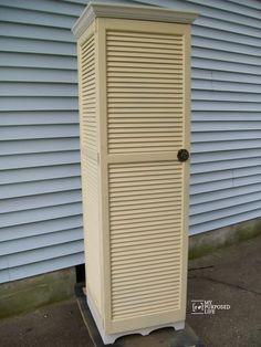oh my! I love this storage cabinet made out of shutters. The light yellow is a perfect color for a cupboard.