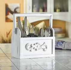 Cool box for large utensils. Beats an old jar.